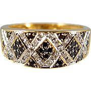 Black and white diamonds and geometrical lines characterize this splendid stamped French 18K solid yellow gold band