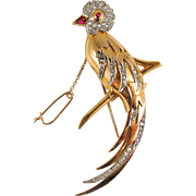 Large and beautiful French art Deco bird of paradise in 18K solid gold covered with 76 rose cut diamonds and red paste security chain Fully stamped
