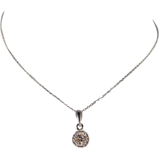 Beautiful gold colored round cut diamond pendant with chain enhanced with 14 brilliant cut white diamonds stamped 14K and 18K fine jewelry