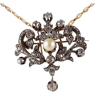 Outstanding Victorian era pendant/brooch in 18K solid gold and silver with a natural pearl and ~1.50ctw diamonds