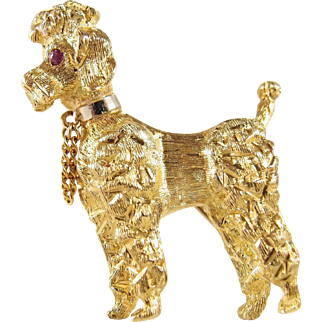 18K solid gold three-dimensional Royal poodle with ruby eyes, heavily textured, hefty weight and perfect condition