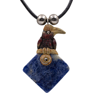 Sodalite Pendant with Hand Carved Tropical Bird