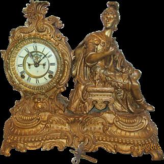 Ansonia Brass Open Escapement Knight Statue Clock