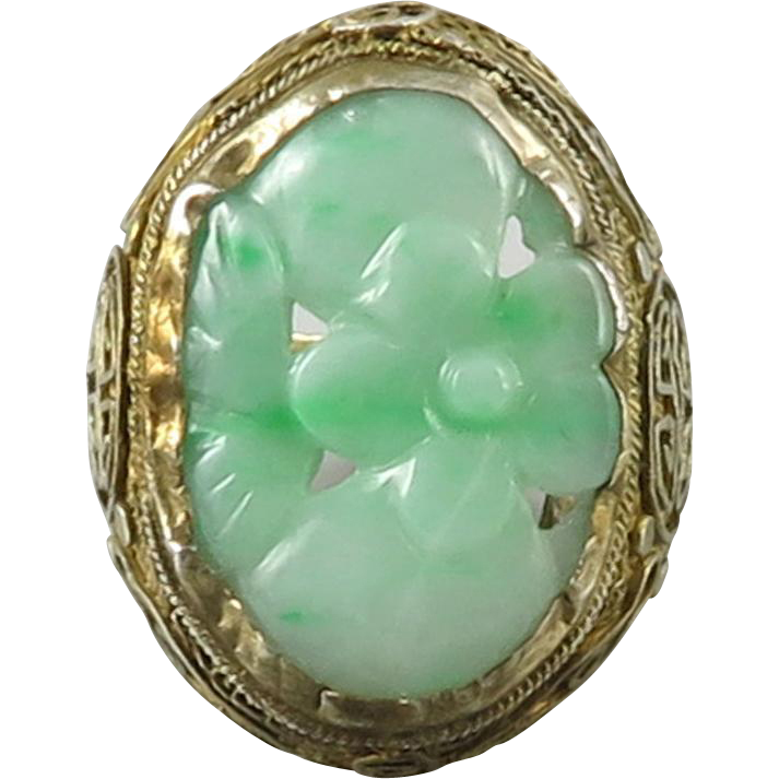 carved jade and gilt silver ring sold on ruby