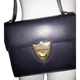 Vintage Paloma Picasso black pebbled textured  leather and gold shield signed purse bag