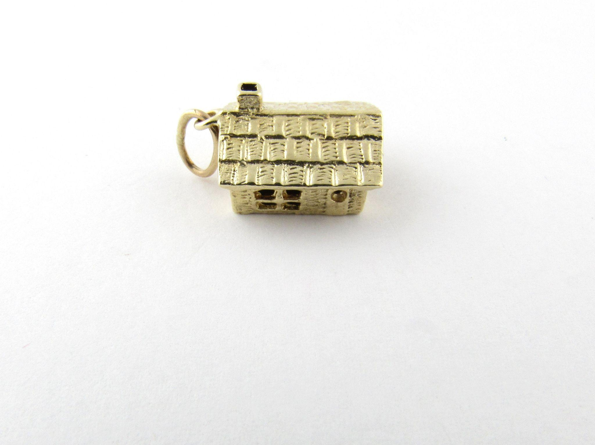 vintage 14 karat yellow gold articulated cabin charm from