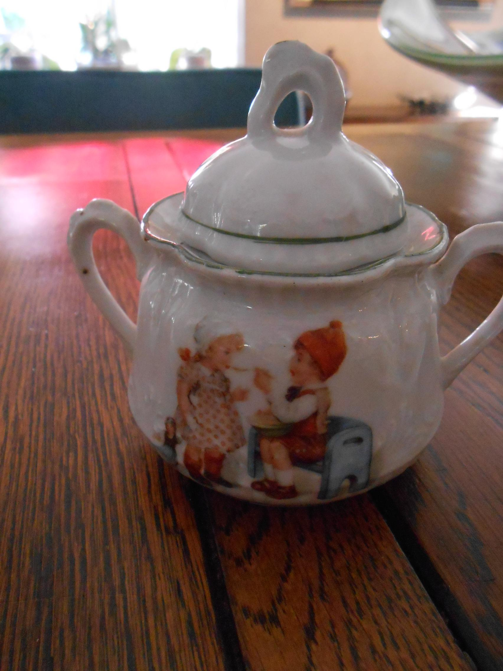 """**an antique child,s tea set with """"PLAYING CHILDREN"""" so ..."""