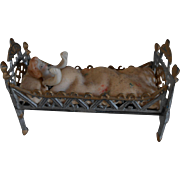 **for your antique doll house ^^^^a miniature soft metal bed with a tiny doll^^^^