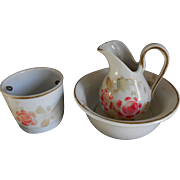 **An Antique porcelain washing set with floral decoration***