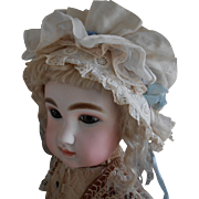 **Beautiful Bonnet for your antique doll** made of antique lace and fabric.