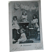 **Sweet picture postcard **girls doing the  dolls laundry***Authentic ! 1904