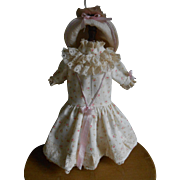 **A Sweet dress with floral decor with a matching hat**for a small doll !