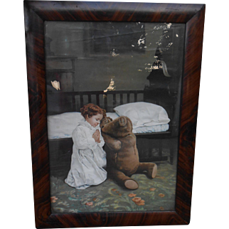 **A sweet image in a frame......A praying girl with her bear...