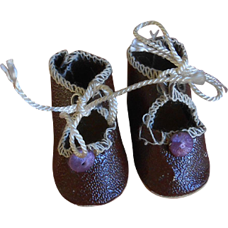 ****A pair of very tiny oil cloth shoes****