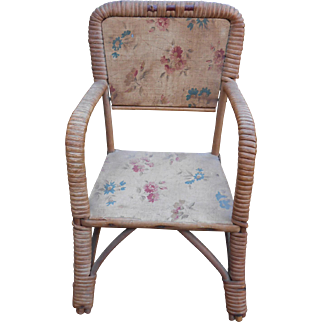 **A beautiful antique chair with floral fabric***usable for a small doll.