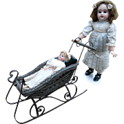 ***A sled and a doll...Wonderful for your Christmas decoration !!****