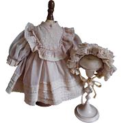 **Sweet dress with a matching bonnet for your small doll****
