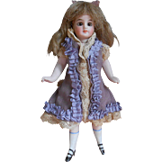 **Beautiful all bisque mignonette doll in original clothes***5,6 inches.