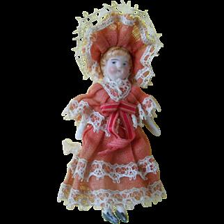 **A sweet little doll...in her original dress.****