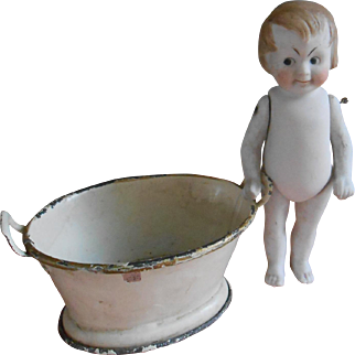 ****A Googly all bisque small doll in his tin bath tub****