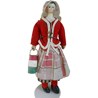 An Early, around 1850, handpainted wooden doll 9,6 inches.