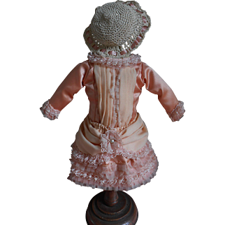 Beautiful dress and matching hat for your cabinet size doll.