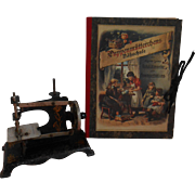 **A Booklet of patterns and a small sewing machine**approx 1900