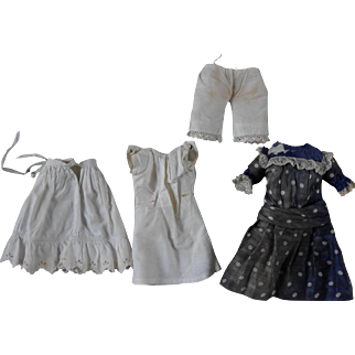 An authentic Dress including underwear for your small doll.
