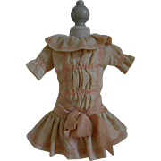 **Amazing small creme dress with pink ribbons and bow****