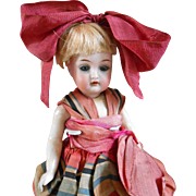 ***All original  8 inches cabinet size doll made by Kammer and Reinhardt****