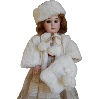 **3-piece of winter clothing made of faux fur..A jacket, muff and hat....**