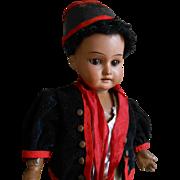 **A mulatto cabinet size doll...all original**