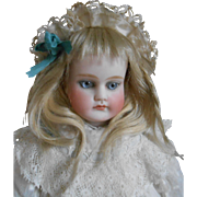 A beautiful, cabinet size, early closed mouth doll with wonderful eyes !!!