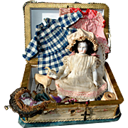 Biedermeier doll 1880 with her trousseau