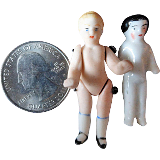 Two tiny German biscuit dolls