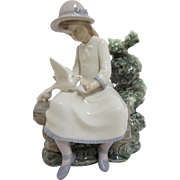 Lladro - Little Girl Feeding Doves