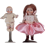 Sweet all bisque doll with an All Bisque Baby