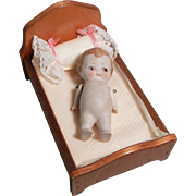 Sweet doll house sized bed with Little German Bisque frozen charlotte doll