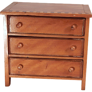 Cute little dresser with inlaid top.