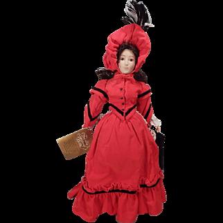 Pretty Franklin Heirloom doll with parasol.