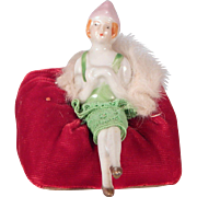 Cute Little Half doll sitting in a chair.