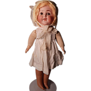 """Darling 17"""" K&K bisque head baby on cloth body."""