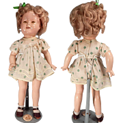 Cute Ideal Shirley Temple Doll with original clothes.
