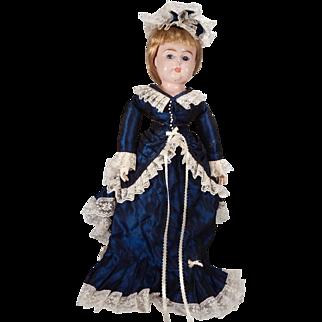 Sweetly Dressed Tin Head Doll