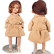 Sweet Cloth and Composition girl with fabulous vintage coat and Play-suit.