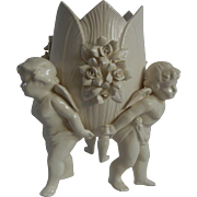 Three Cherubs Creamy White Porcelain Vase with Hand Molded Flowers