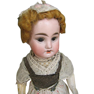 French bisque doll in traditional costume 12 inches or 30 cm