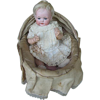 Baer & Prochild 604 baby doll in bassinet,  doll is 9 inches or 23 cm.
