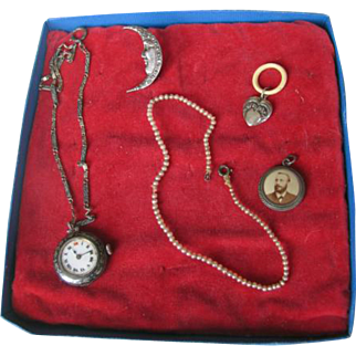 Doll accessories 5 different  watch,rattle, silver moon ,neckles, and portret hanger.