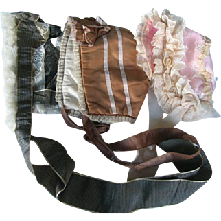 Three bonnets fits 30 to 34 inches dolls